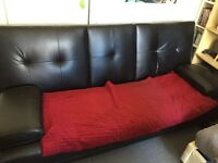 Faux leather sofa bed with cup holders needs attention but in good working order