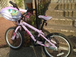 Girls Bike with alligator attachment to an adult bike