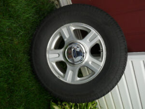 set of four winter tires on  aluminum rims for sale.