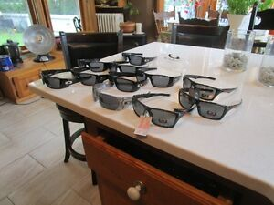 "Cool looking , Logo sunglasses  "" O ""  !!!!...2 for $ 50."