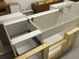 10 feet new kitchen cabinet boxes (Your design )+ installation.