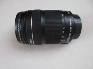 Canon EF-S 18 -135 mm 1:3.5-5.6 IS STM lens with cap covers