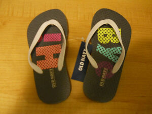 BRAND NEW tags on. OLD NAVY girls flip flops Size 10/11