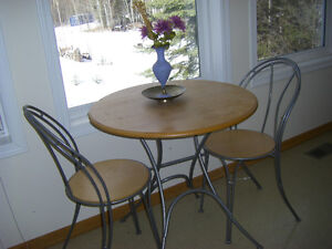 small round table and two chairs