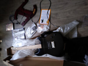 BRAND NEW GUITAR WITH STAND FOR SALE $125,bag,softwear
