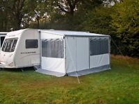 Caravanstore zip 410 Awning complete with storage bag and blue/yellow stripe curtains. £440.00