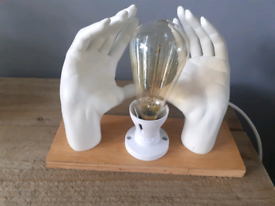 Upcycled mannequin hand light
