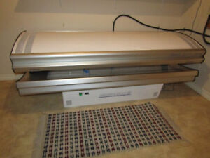 Solana Generation IV tanning bed with hour meter