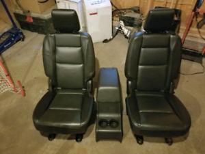 Black leather bucket seats