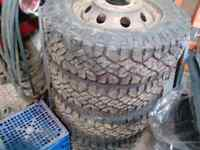 6 new tires + rimsfor 1 ton cube truck ( off a kent homes truck)