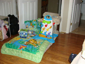package of baby items.. crib set, travel play blanket, stroller