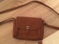 Accessorize over the shoulder brown handbag
