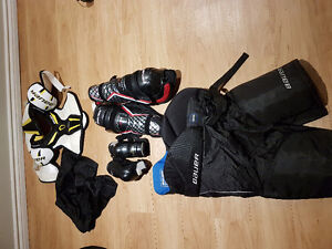 Young ladies hockey bag and equipment.