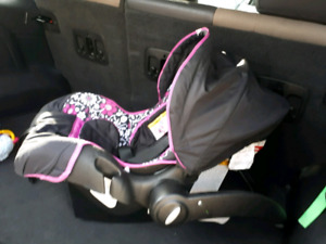 Pink and black baby car seat