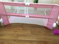 Pink Lindam bed guard.