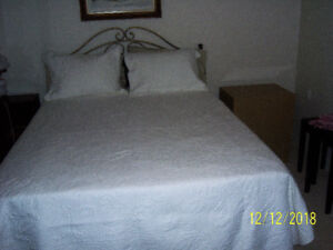 Queensize Bed - complete with frame, headboard etc.