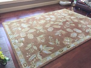 "8'10"" x 11'3"" natural wool area rug"