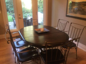 Solid wood table with wrought iron base and 6 chairs