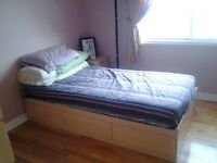 Twin wooden bed + mattress