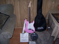 Pink fender squier guitar with strap, amp, and carry bag