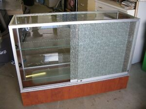Glass showcases with sliding glass doors