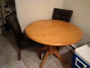 Hardwood kitchen table with leather chairs