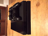 PS4 EXCELLENT CONDITION WITH GAMES AND TWO CONTROLLERS!