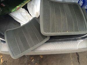 Two (2) winter carpets back seats like new