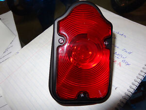 Harley tombstone tail light NEW    recycledgear.ca