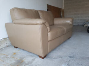 100%  Leather Loveseat $1800 from Sears