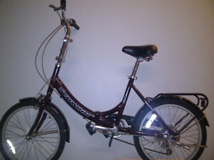 "Vélo Aluminium pliable Schwinn (neuf utilisé 1 mois) pneus 20""."
