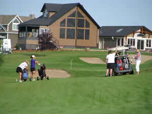 Live at Alberta's Best Gated Lakeside Golf Snowbird Community