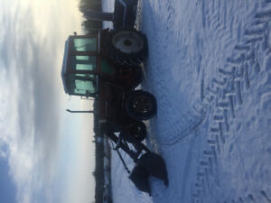 Belarus tractor with loader and snow blower