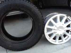 215/70/15 Bridgestone Winter Tires & 15x6.5 Ford Alloy Rims Belleville Belleville Area image 1