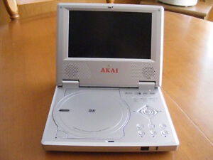 """PORTABLE DVD PLAYER 7"""" WIDE & CASE"""