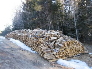 Seasoned Hardwood Firewood. cut, split and delivered