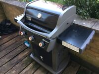 Two Weber Grills - Gas and Charcoal
