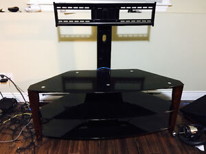 Excellent condition tv stand for 65 inch. Tempered glass.