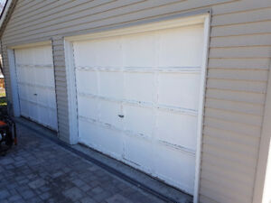 two 9 ft wide 7 ft high garage door panels