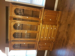 Solid Oak china cabinet with table and 4 chairs