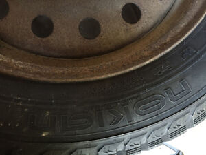 Like new four Nokian Nordman 5 Winter tires on rims