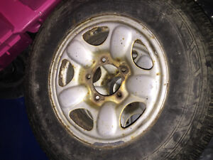 Geo tracker 5 bolt rims with snow tires $50