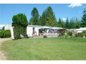A home and 2 acres of flat usable land on a quiet street!
