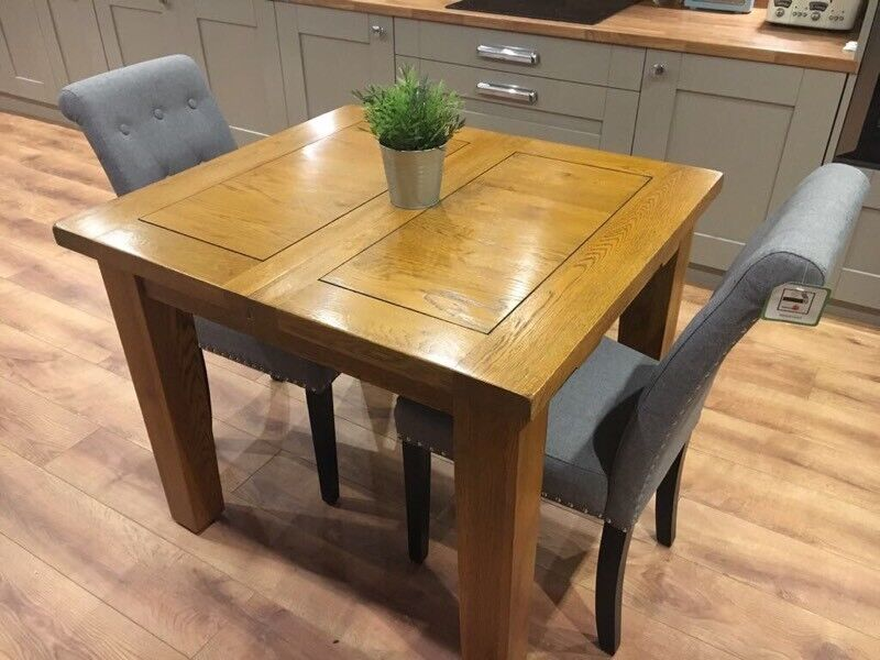 Brand new solid oak extending dining table