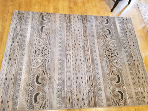 Beautiful low pile area rug brand new 63 in x 88 in