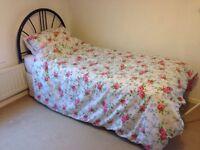 Single Divan bed with headboard.
