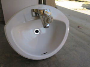 White Bathroom Sink with Faucet and Counter-top in Salmon Arm