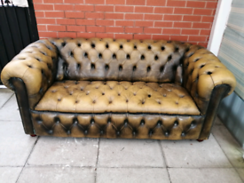 A Light Green/Tan Leather Chesterfield Buttoned Sofa