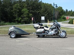 motorcycle with fibrobec trailer