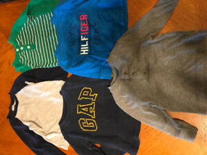 Five 12 month boy long sleeve shirts. $2 each or $8 for all.